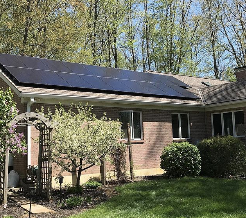 Solar panel roof on a home in the woods.